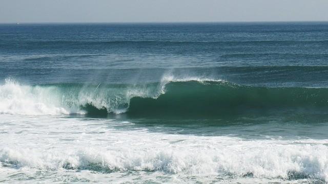 Meerewellen und Strand.  Veränderungen akzeptieren lernen!
